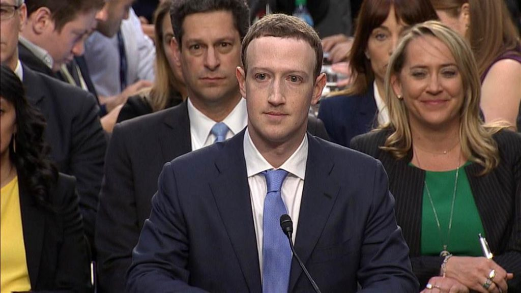 zuck_in_chair_smiling_vacuously